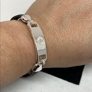 Leather and silver tone bracelet